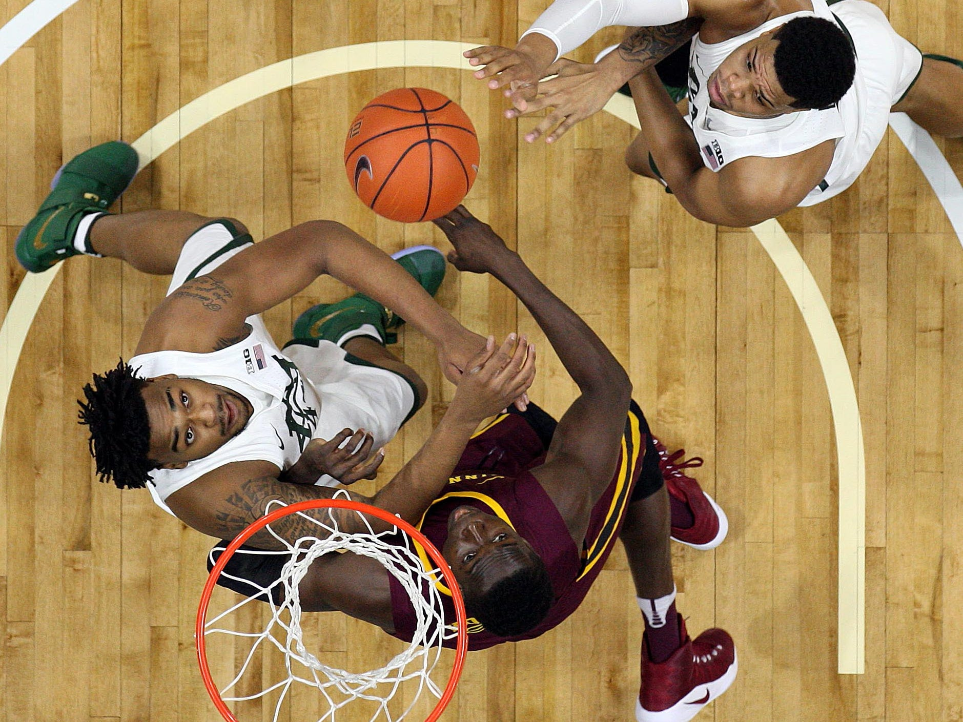 Mike Carter / USA TODAY Sports Michigan State?s Nick Ward, left, and Alvin Ellis, right, battle for a rebound against Minnesota on Jan. 11 in East Lansing. The Spartans won that game, 65-47, sweeping the regular-season series for two of MSU?s signature wins thus far. Jan 11, 2017; East Lansing, MI, USA;  Michigan State Spartans forward Nick Ward (44) and Minnesota Golden Gophers center Bakary Konate (21) and Michigan State Spartans guard Alvin Ellis III (3) fight for a loose ball during the first half of a game at Jack Breslin Student Events Center. Mandatory Credit: Mike Carter-USA TODAY Sports
