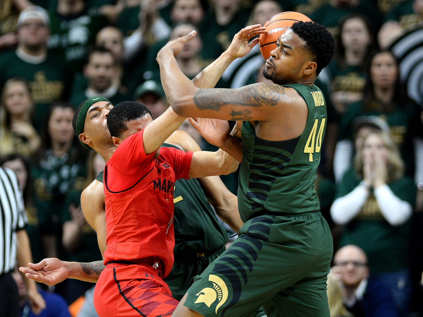 Michigan State's Nick Ward, right, collides with Maryland's Anthony Cowan Jr. during the second half on Thursday, Jan. 4, 2018, at the Breslin Center in East Lansing. Ward was called for a foul on the play. The Spartans won 91-61.