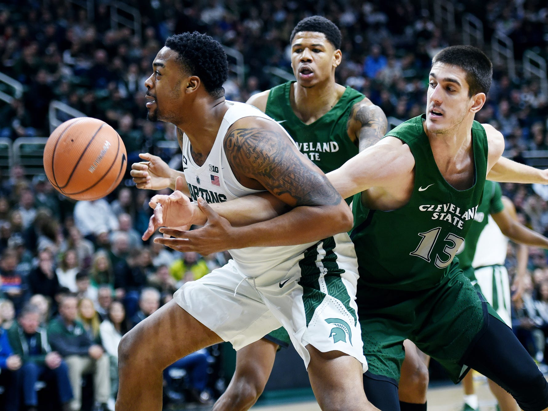 Michigan State's Nick Ward, left, gets tangled up with Cleveland State's Stefan Kenic, right, while going for a rebound during the first half on Friday, Dec. 29, 2017, at the Breslin Center in East Lansing.