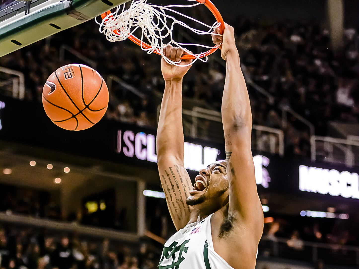 Nick Ward of MSU slams the ball home after an alley-oop feed from Cassius Winston in the 1st half of their game with Wisconsin Sunday February 26, 2017 in East Lansing.  KEVIN W. FOWLER PHOTO