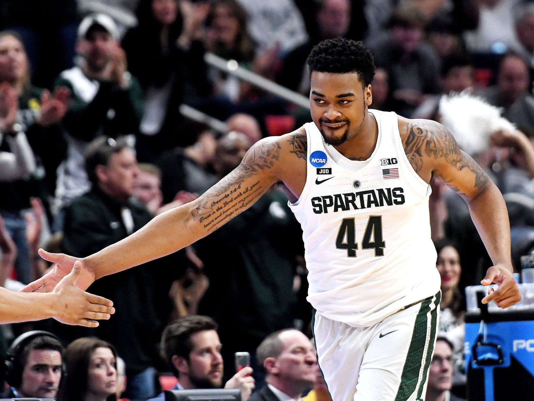 Michigan State's Nick Ward celebrates after his dunk during the first half on Sunday, March 18, 2018, at the Little Caesars Arena in Detroit.