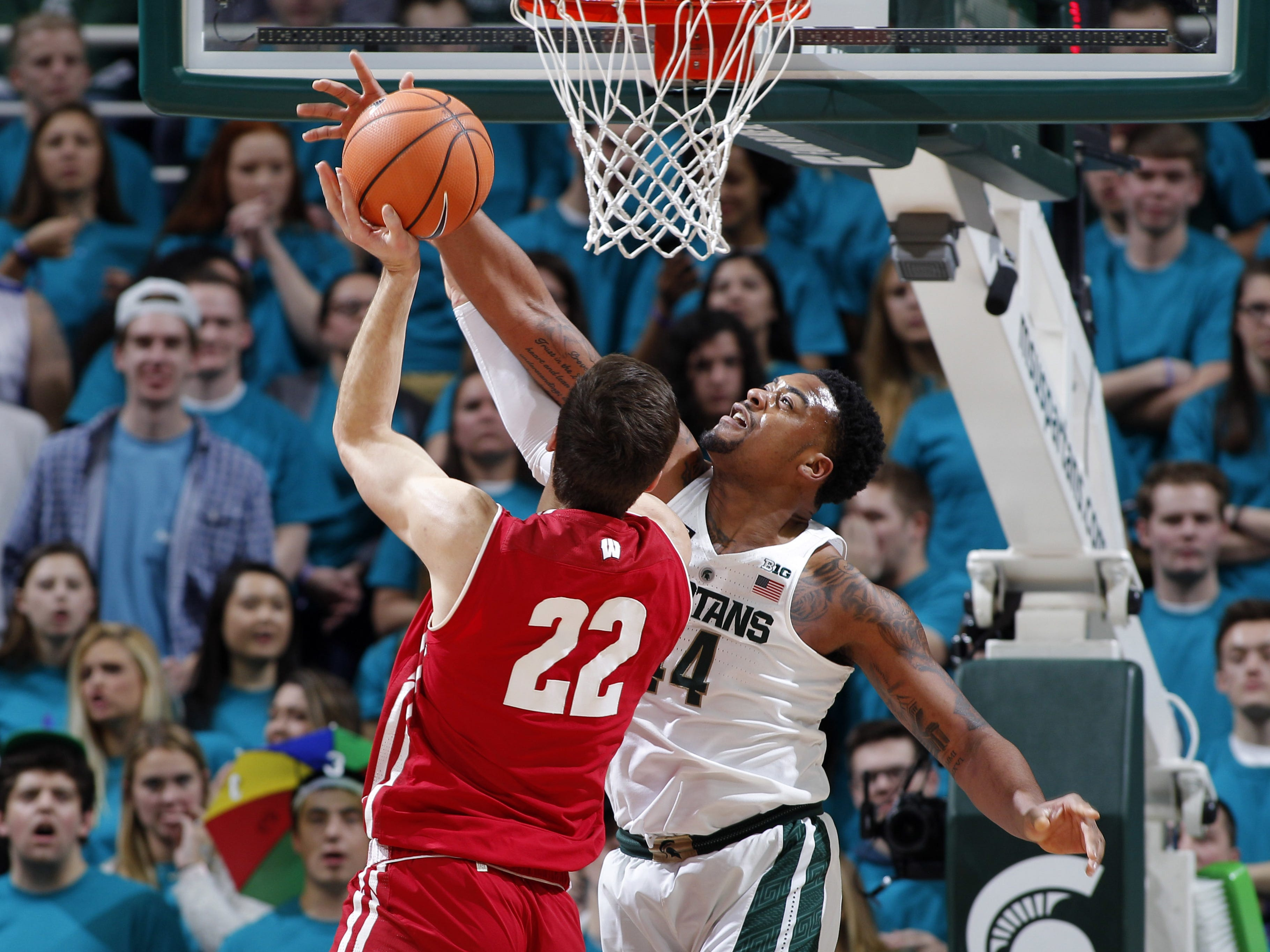 Michigan State?s Nick Ward blocks a shot by Wisconsin?s Ethan Happ during the first half Friday in East Lansing.  al goldis/AP Michigan State's Nick Ward, right, blocks a shot by Wisconsin's Ethan Happ (22) during the first half of an NCAA college basketball game Friday, Jan. 26, 2018, in East Lansing, Mich. (AP Photo/Al Goldis)