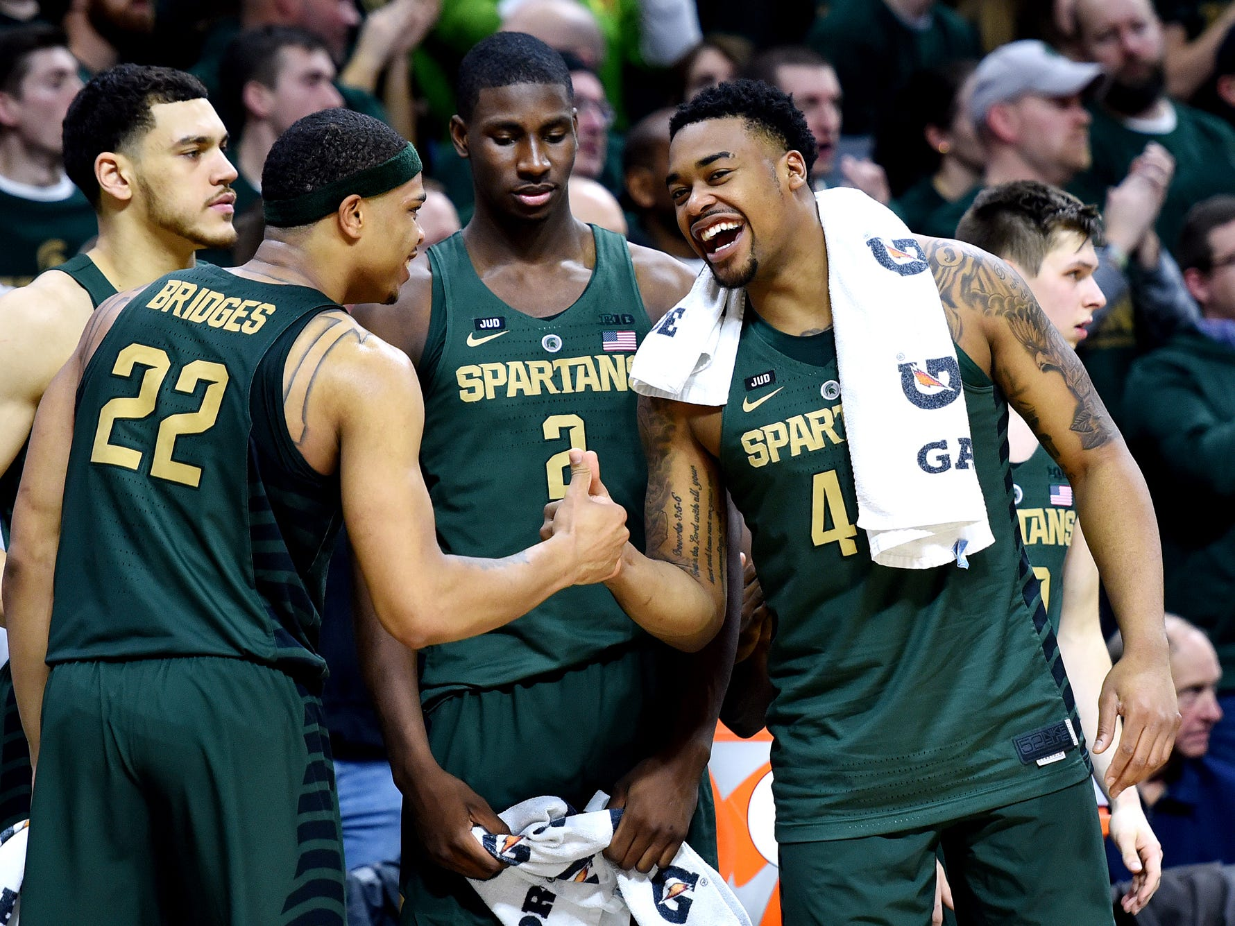 From left, Michigan State's Gavin Schilling, Miles Bridges, Jaren Jackson Jr. and Nick Ward celebrate on the bench during the second half on Thursday, Jan. 4, 2018, at the Breslin Center in East Lansing. The Spartans won 91-61.