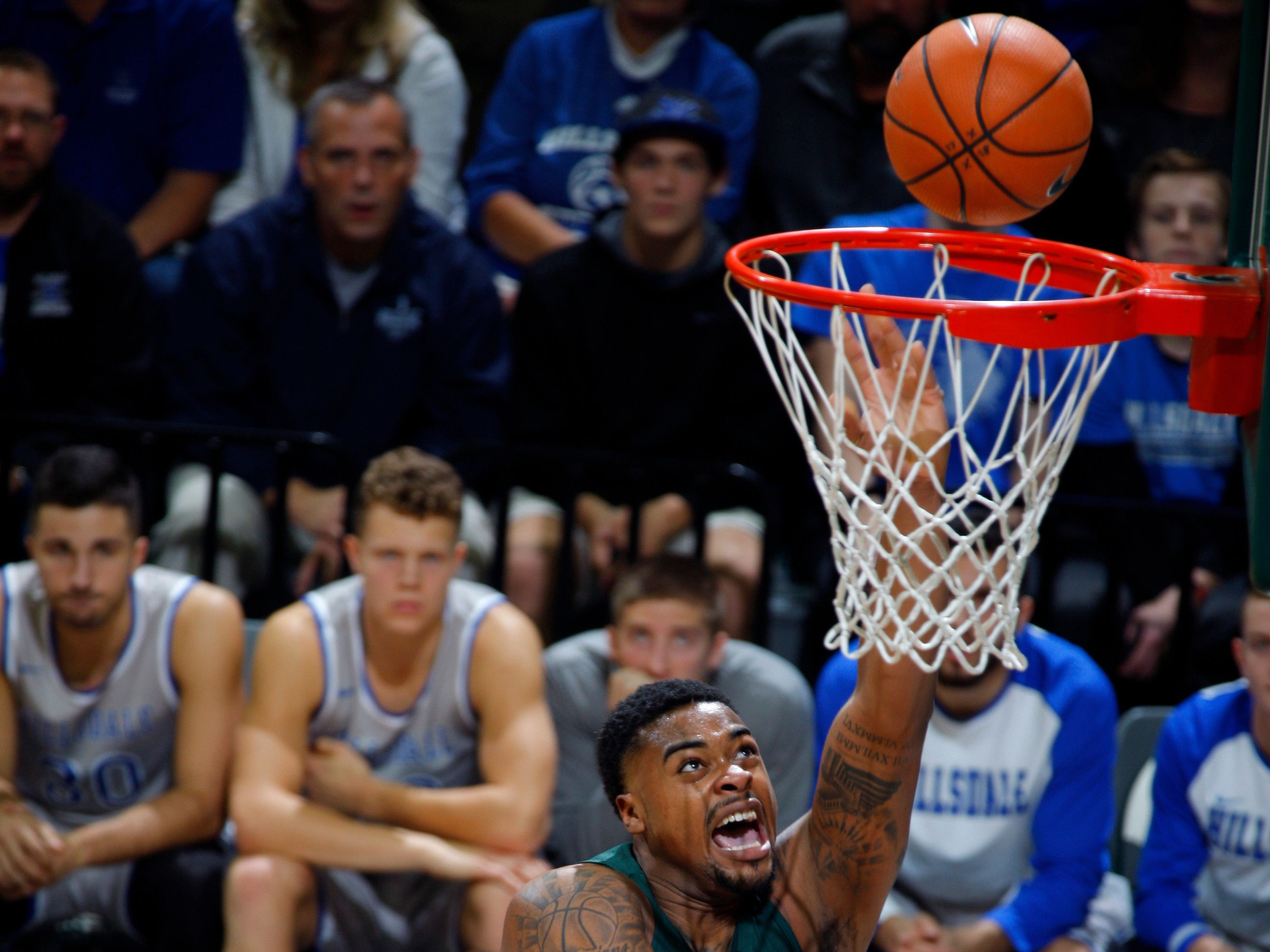 Michigan State?s Nick Ward shoots against Hillsdale?s Gordon Behr (33) during the first half Friday in East Lansing.   Al Goldis/AP Michigan State's Nick Ward, rear, shoots against Hillsdale's Gordon Behr (33) during the first half of an NCAA college basketball exhibition game, Friday, Nov. 3, 2017, in East Lansing, Mich.