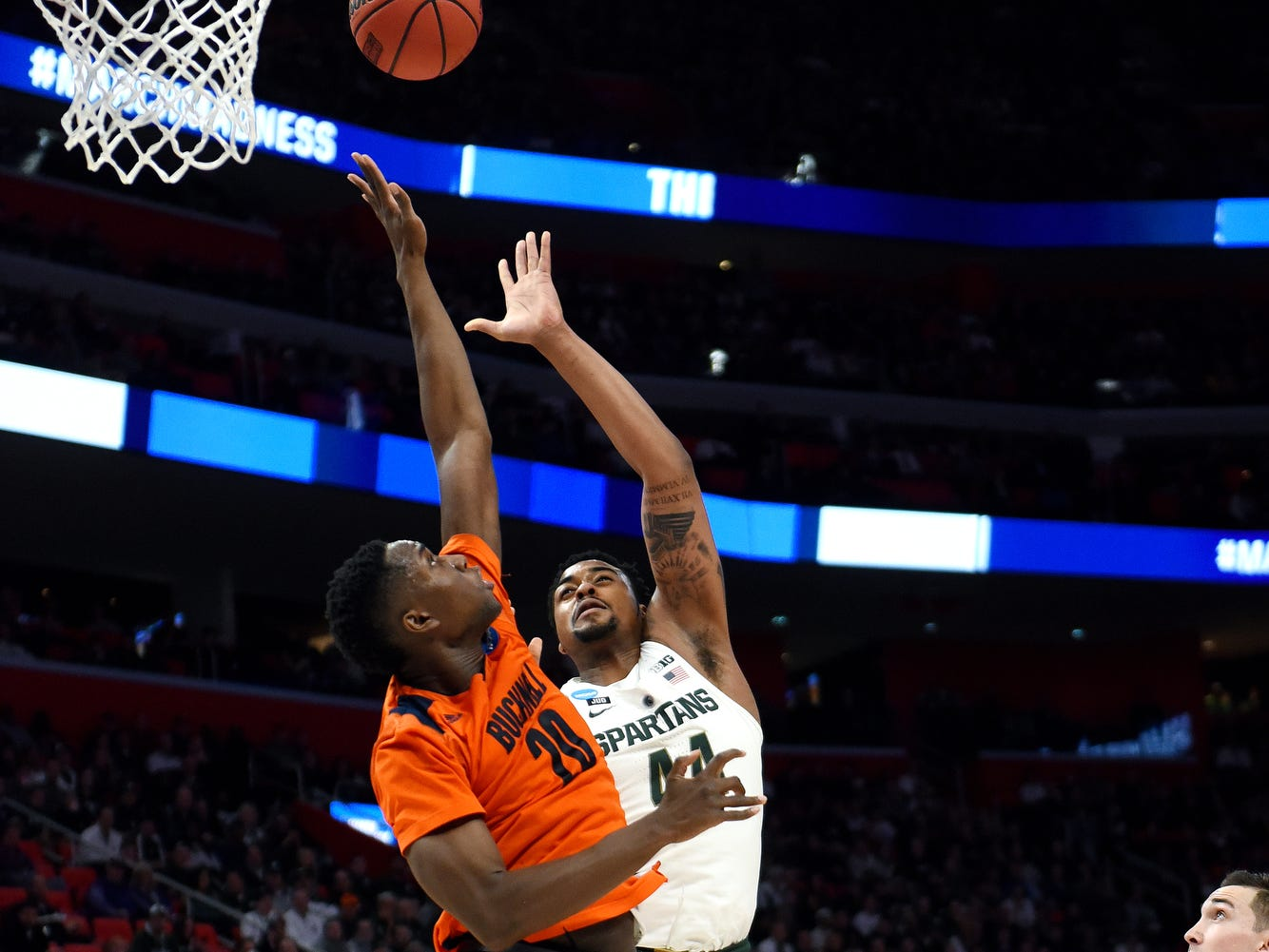 Michigan State's Nick Ward, right, shoots as Bucknell's Nana Foulland defends during the second half on Friday, March 16, 2018, at the Little Caesars Arena in Detroit. The Spartans beat Bucknell 82-78 to advance to the second round in the NCAA tournament.