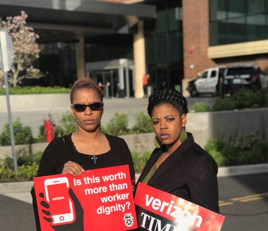 Tasha Murrell, right, stands outside a Verizon shareholders meeting in Renton, Wash., in May 2018. Murrell worked at XPO Logistics in Memphis, which distributes retail products for Verizon and Disney worldwide. While at XPO, she requested a reprieve from lifting heavy boxes while pregnant in 2014. Murrell miscarried after, she says, that request was denied.