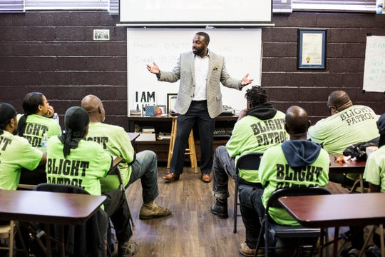 DeAndre Brown speaks to members of the Blight Patrol while at Lifeline to Success on Oct. 25, 2018. Brown, once incarcerated, co-founded the organization Lifeline to Success with his wife, Vinessa Brown. Through keeping in touch over the phone while incarcerated, Brown's family helped him bridge the gap between his commitment to change and the harsh realities of incarceration.