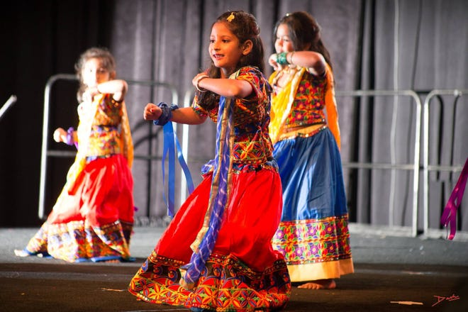 As part of the cultural experience at India Fest, guests can enjoy traditional Indian music and dance.