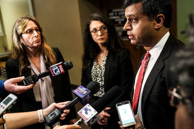 October 29 2018 - Juni Ganguli, right, one of Tremaine Wilbourn's defense attorneys, speaks with media outside of Judge Lee Coffee's courtroom at 201 Poplar. Wilbourn is charged with fatally shooting Memphis police officer Sean Bolton shortly after 9 p.m. on Aug. 1, 2015, in the 4800 block of Summerlane in the area of Cottonwood and South Perkins.