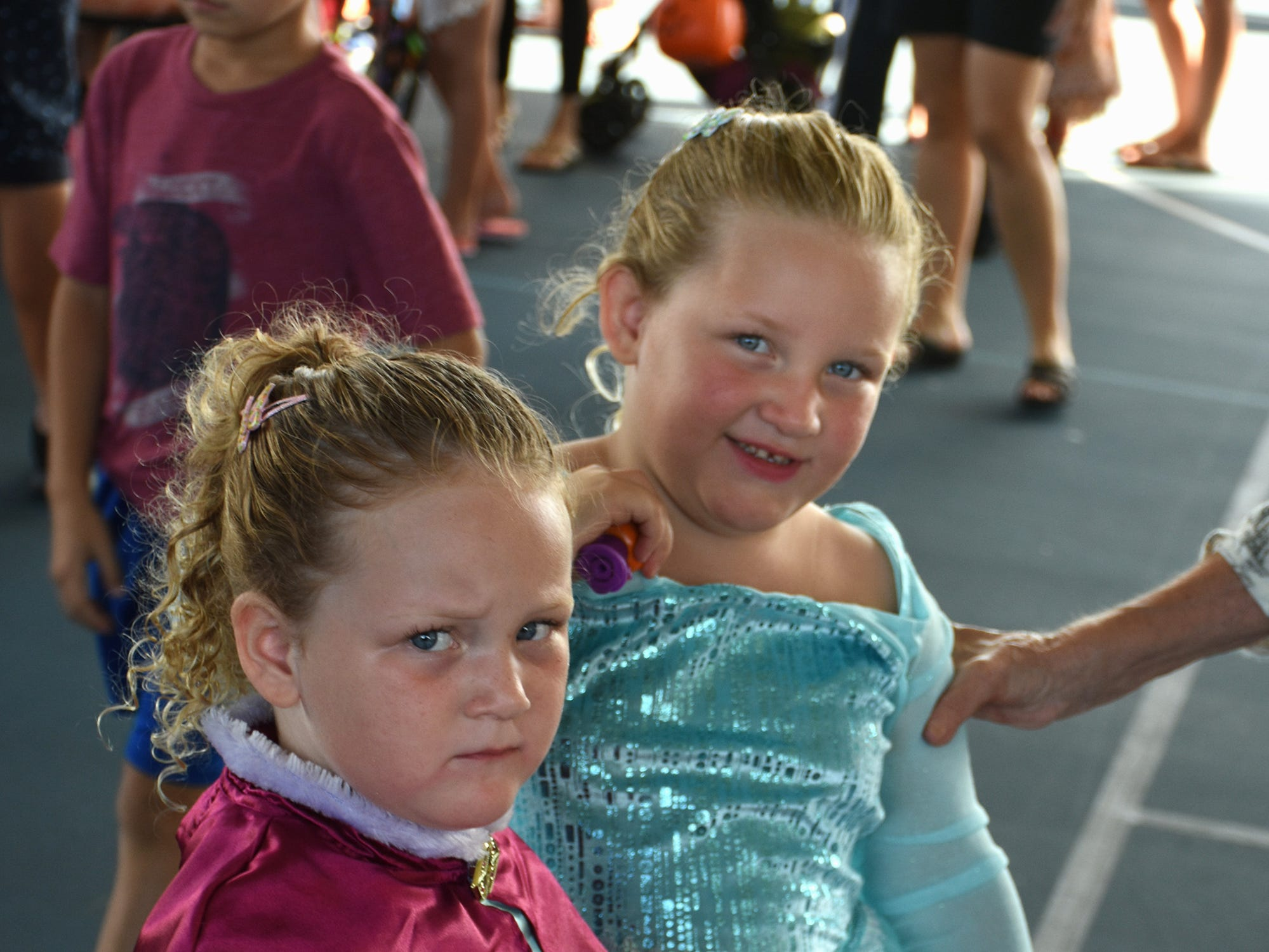 Ariana and Amelia Buckhold like their balloon animals, but not the loud DJ beat. The Spooktacular, the City of Marco Island's pre-Halloween celebration, returned to Mackle Park's air-nasium on Saturday afternoon, with costumes, games and family fun.