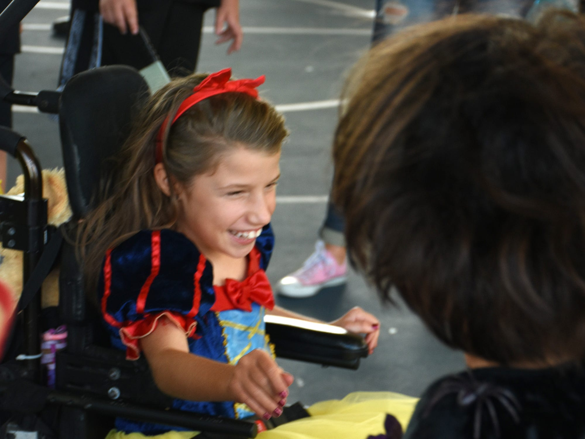 Caylee Thompson, 9, rocks her Snow White costume. The Spooktacular, the City of Marco Island's pre-Halloween celebration, returned to Mackle Park's air-nasium on Saturday afternoon, with costumes, games and family fun.