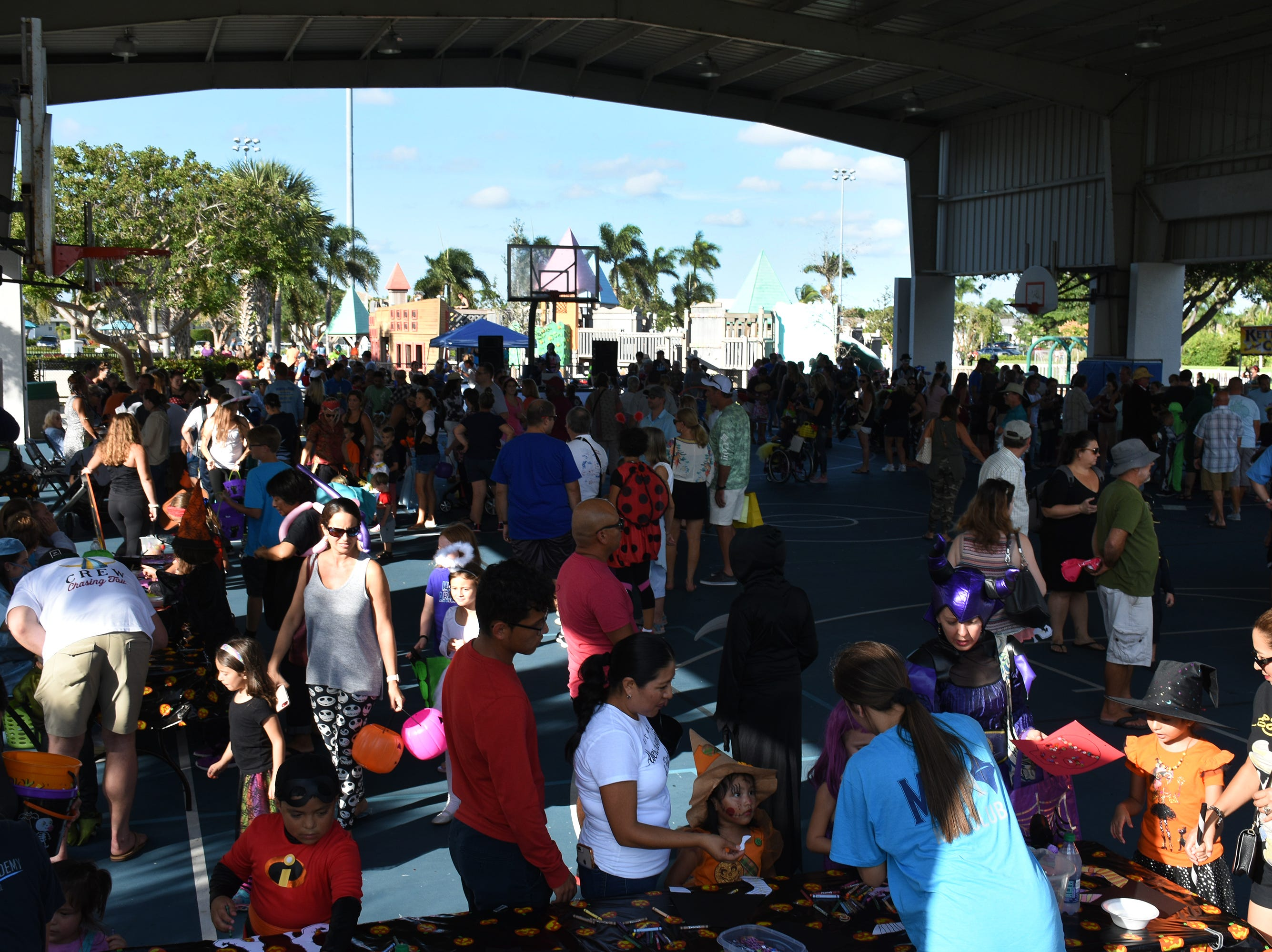 Revelers throng the air-nasium. The Spooktacular, the City of Marco Island's pre-Halloween celebration, returned to Mackle Park's air-nasium on Saturday afternoon, with costumes, games and family fun.