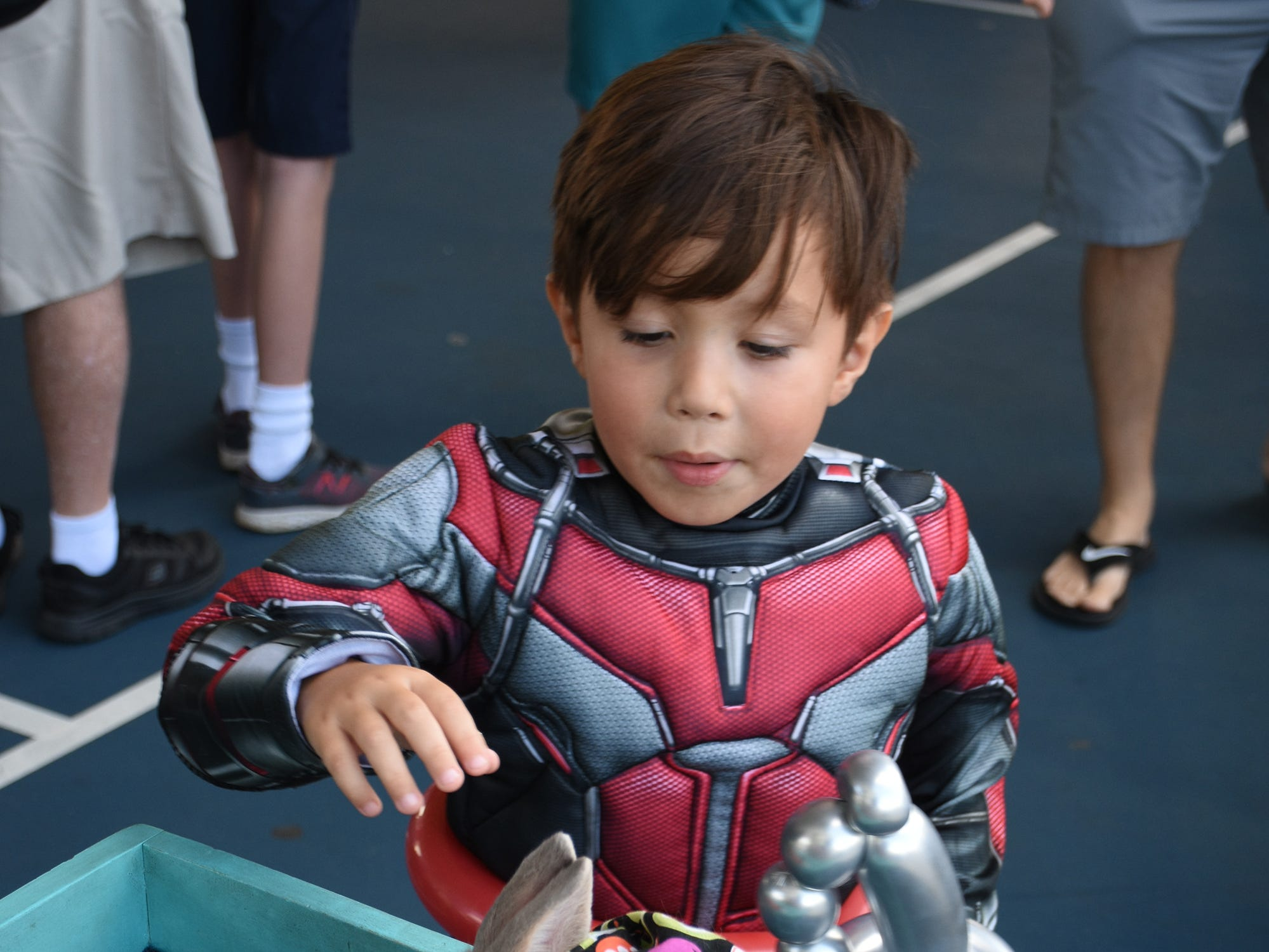 Even a superhero like Matias Broughton, 4, can fall for a soft furry bunny. The Spooktacular, the City of Marco Island's pre-Halloween celebration, returned to Mackle Park's air-nasium on Saturday afternoon, with costumes, games and family fun.