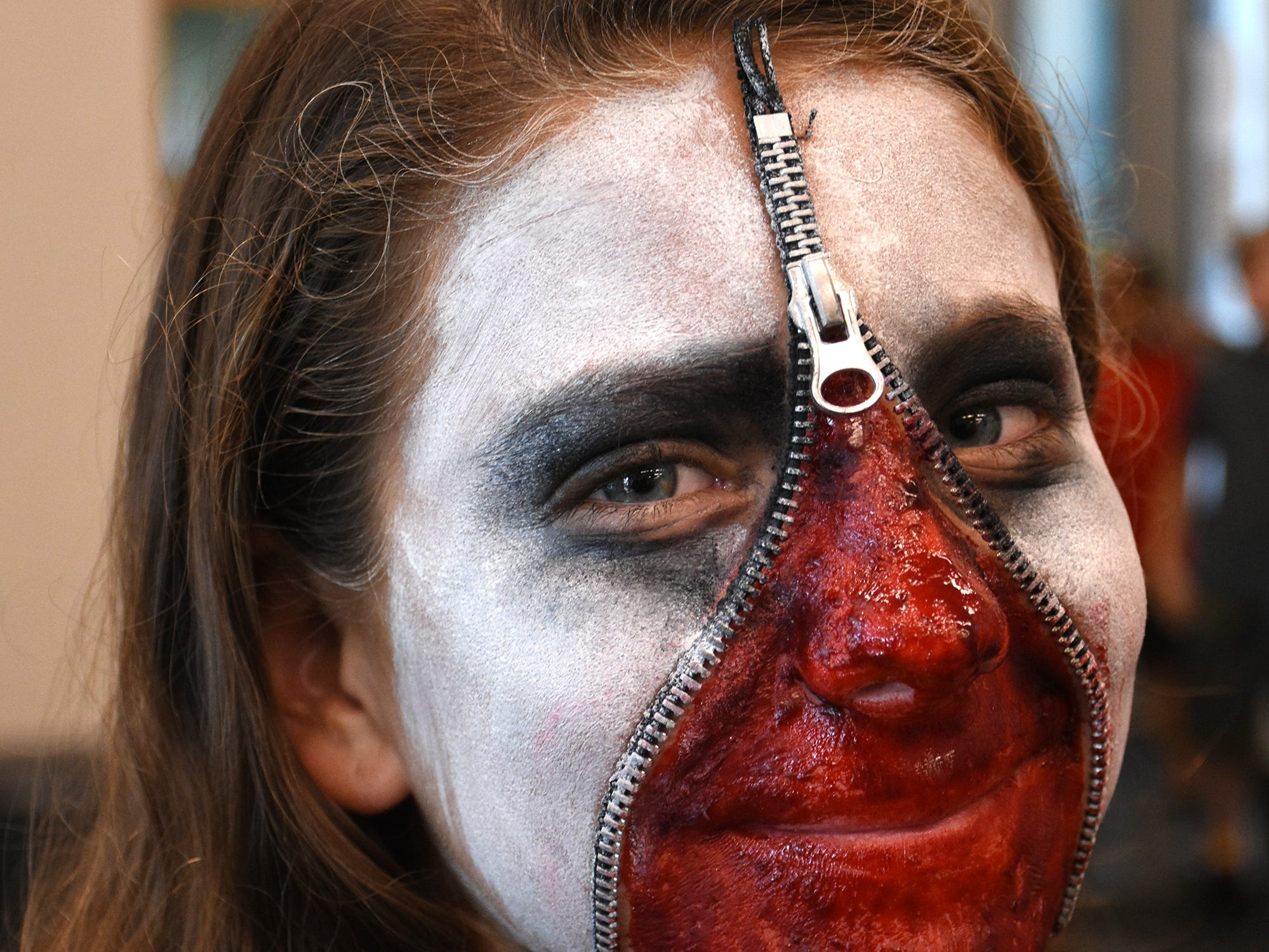 Mary Montgomery, 11, seems to have unzipped her face. The Spooktacular, the City of Marco Island's pre-Halloween celebration, returned to Mackle Park's air-nasium on Saturday afternoon, with costumes, games and family fun.