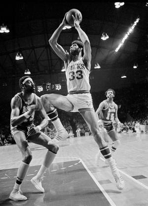 Milwaukee Bucks star Lew Alcindor (33) stretches his long frame as he drives past Los Angeles Lakers Wilt Chamberlain (13) towards basket April 18, 1971 during NBA playoffs at Milwaukee. Alcindor changed his name legally to Kareem Abdul-Jabbar heading into the 1971-72 season.