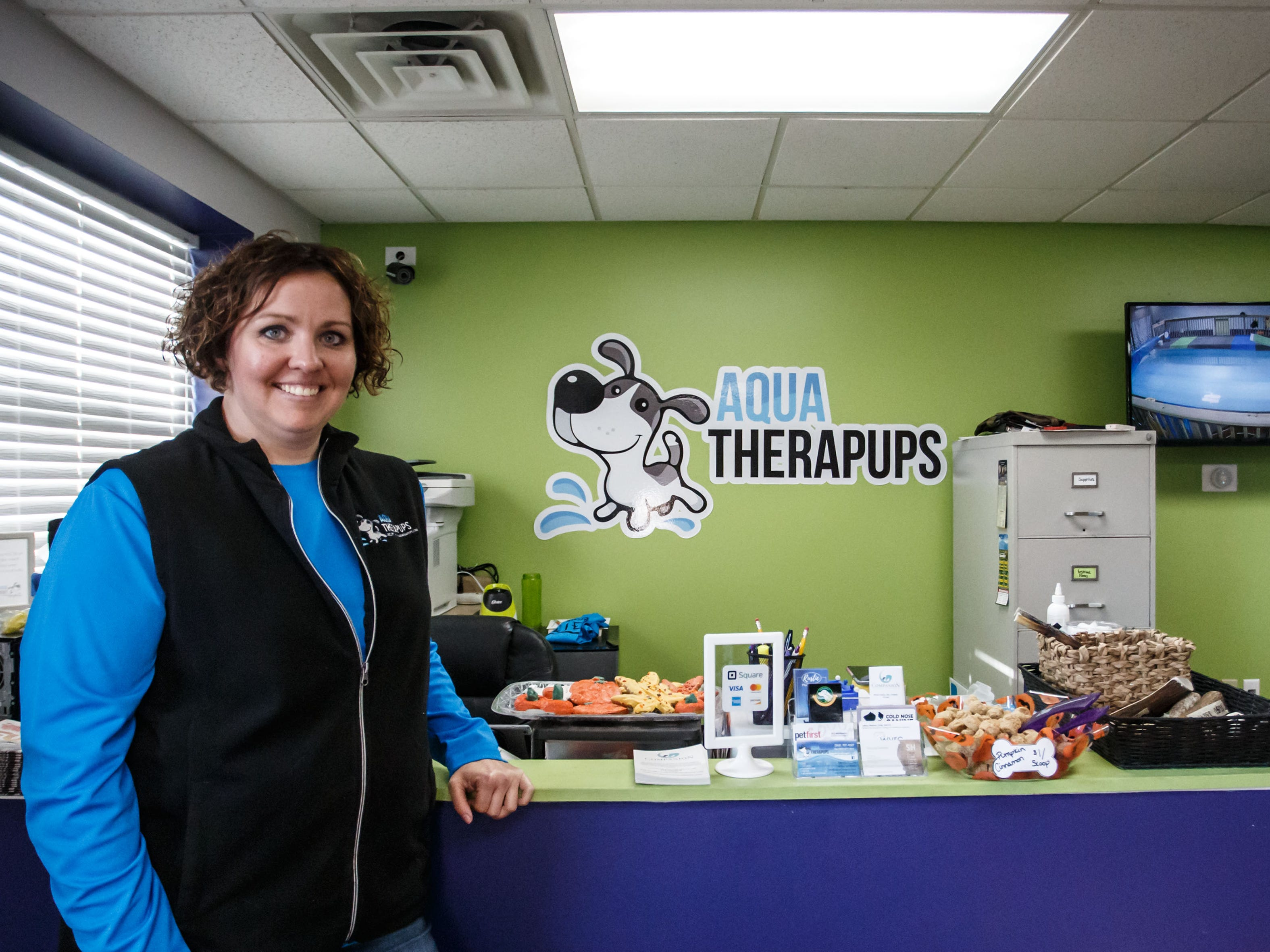 Owner/trainer Becky Pease of Aqua Therapups in Slinger greets customers at the facility on Monday, Oct. 29, 2018. The business is opening a second location in Brookfield this November.