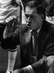 Larry Costello is shown coaching in 1971.
