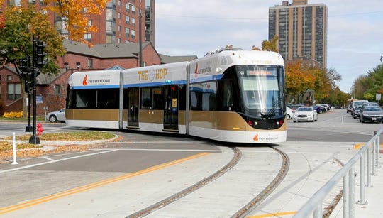 The Milwaukee streetcar, The Hop, turns on to East Kilbourn Avenue near Cathedral Square. Local officials and the media took a preview ride on the Milwaukee streetcar, The Hop, on Monday.