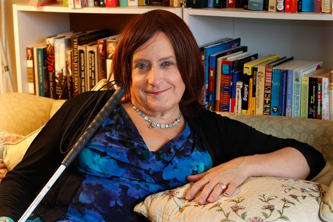 """Carla Ernst has written a new book, """"Life Without Pockets,"""" about her journey as a transgender woman. She was photographed at her home in Wauwatosa."""