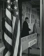 A couple leave the polling place at Bruce Elementary School, 6453 N. 89th St., after casting their votes in the Nov. 5, 1968, election. This photo was published in the Nov. 6, 1968, Milwaukee Journal.