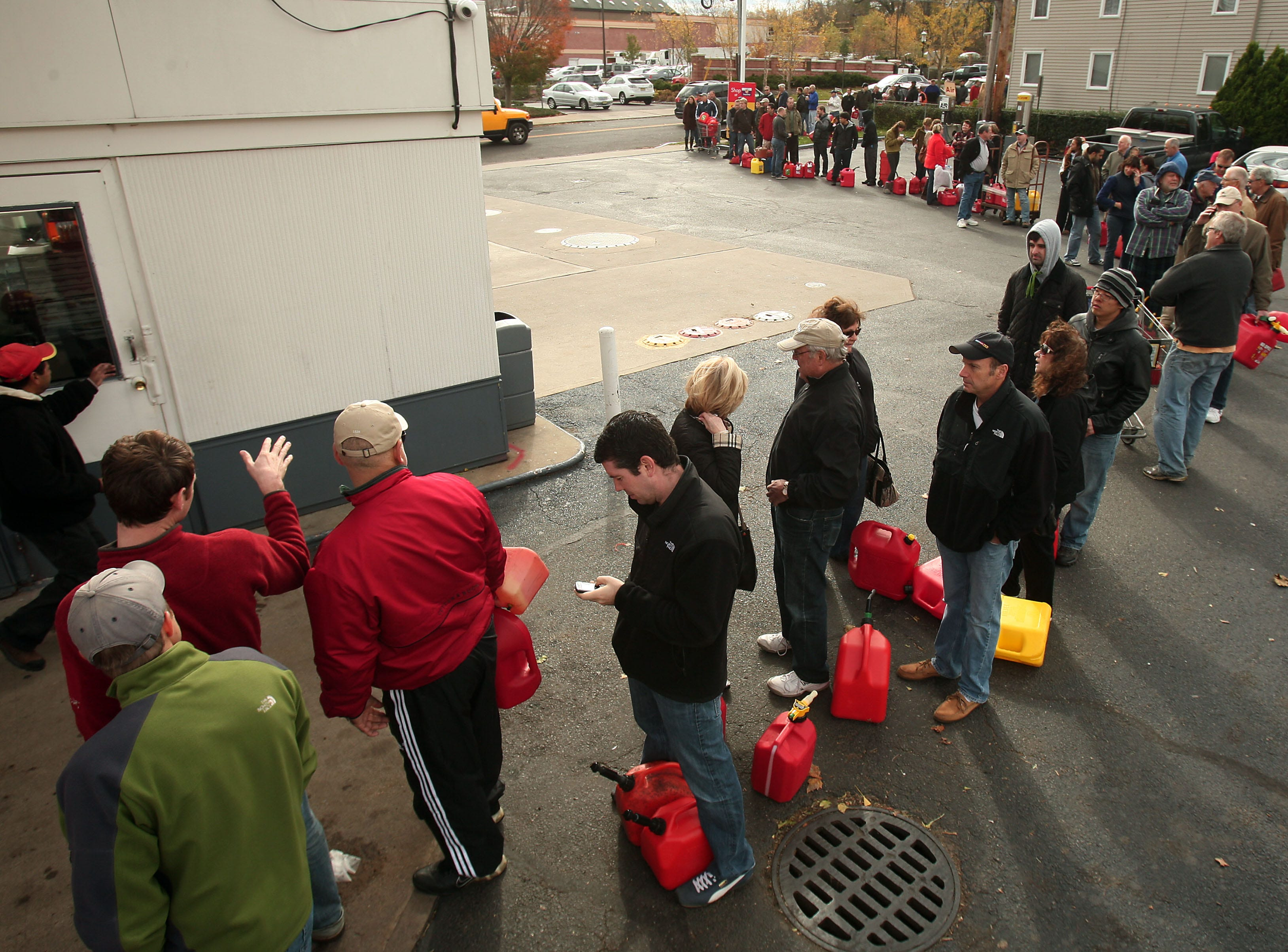 Madison, NJ- November 1, 2012--Residents line up at Madison Shell  to fill up cars and gas cans as locals continue the recovery process after Hurricane Sandy devastated the eastern seaboard.