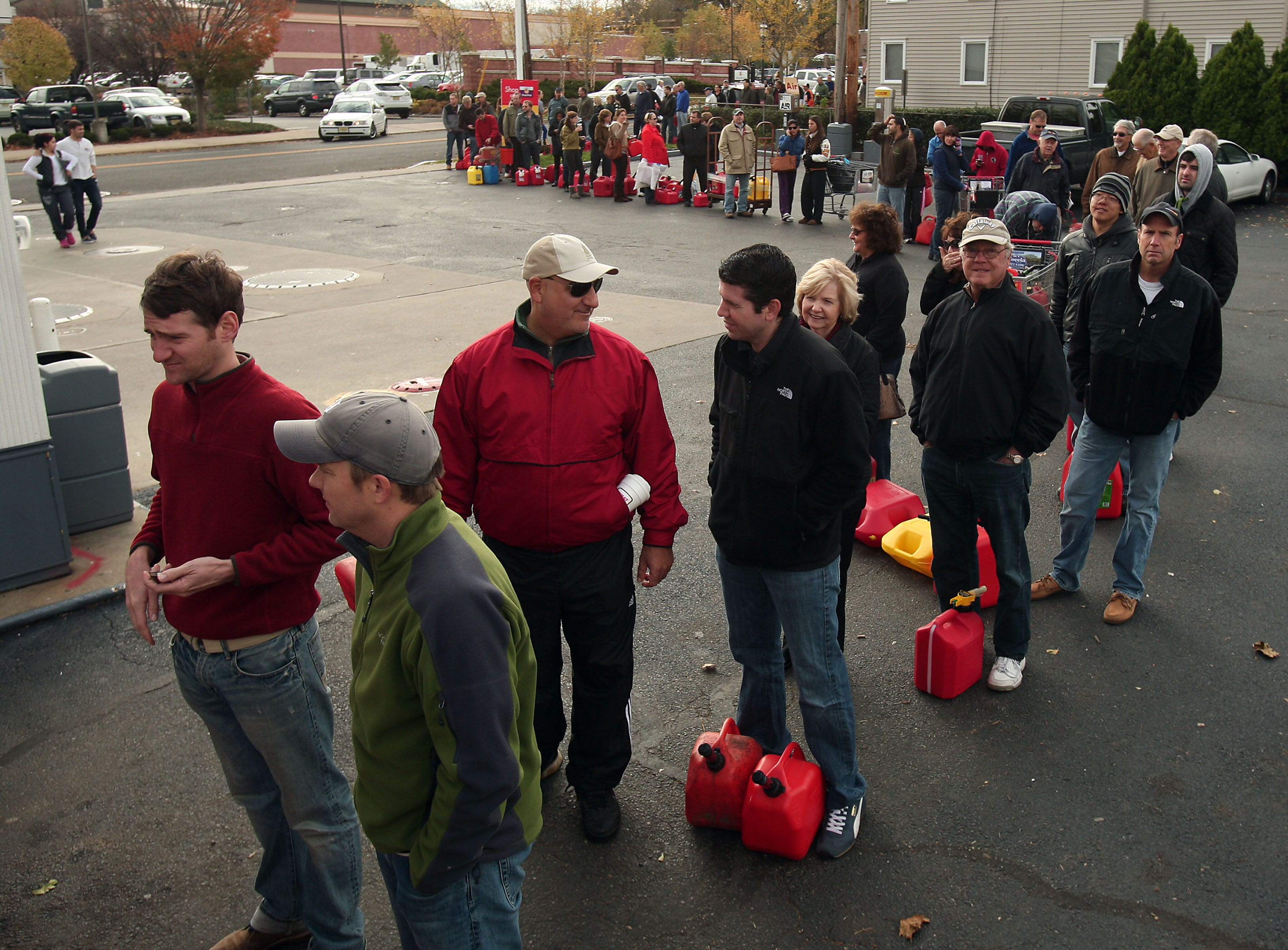 Madison, NJ- November 1, 2012--Residents line up at Madison Shell  to fill up cars and gas cans as locals continue the recovery process after Hurricane Sandy devastated the eastern seaboard.Bob Karp/Staff Photographer/DAILY RECORD