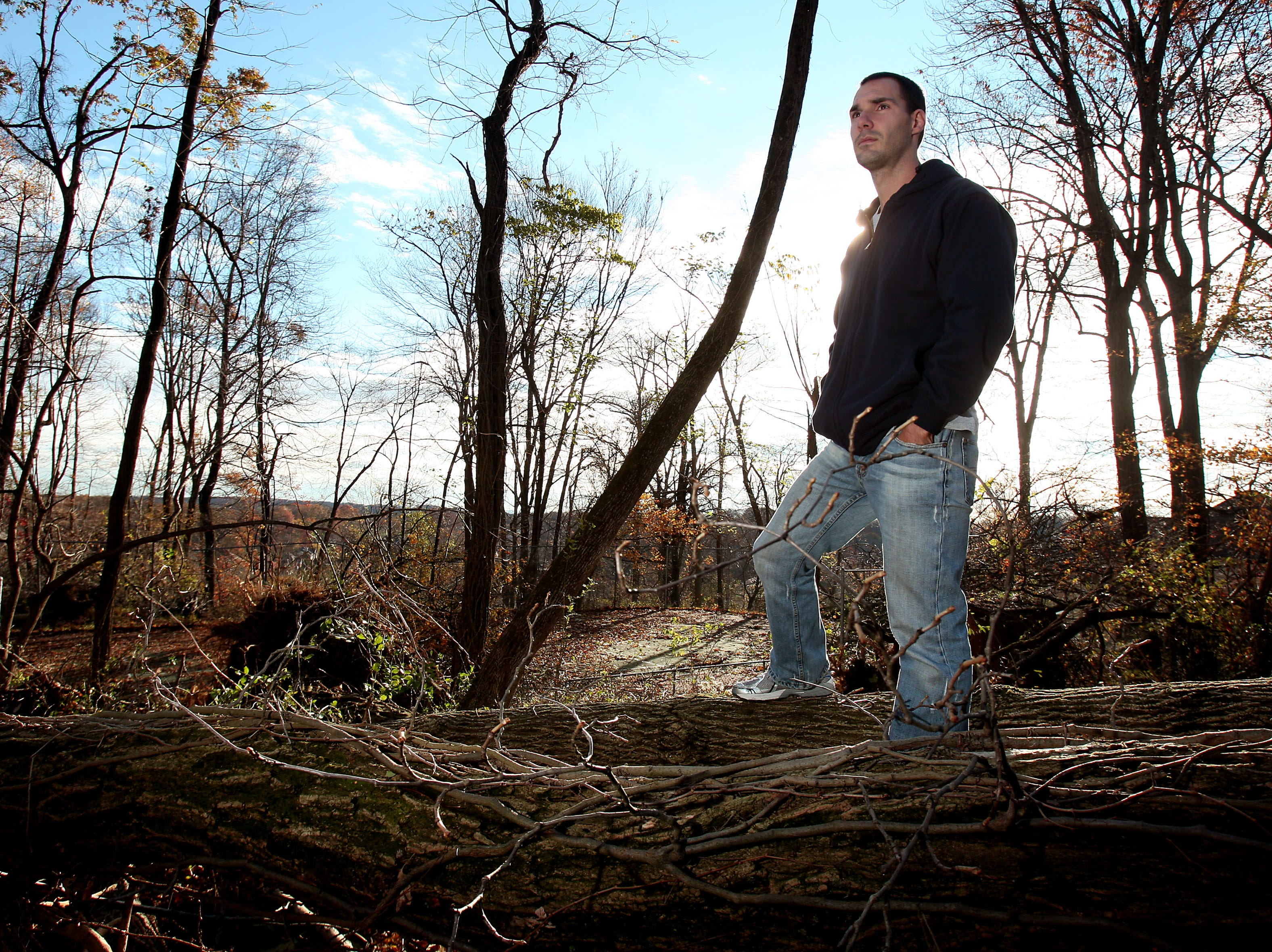 Morristown, NJ- November 2, 2012--Matthew Iglesias surveys his property on Stratford Court in Morristown, NJ. Matthew and his wife Kristi just closed on the home three weeks ago. During Hurricane Sandy, over twenty large tree came down on and around their home making the property and streets around it inaccessible. 