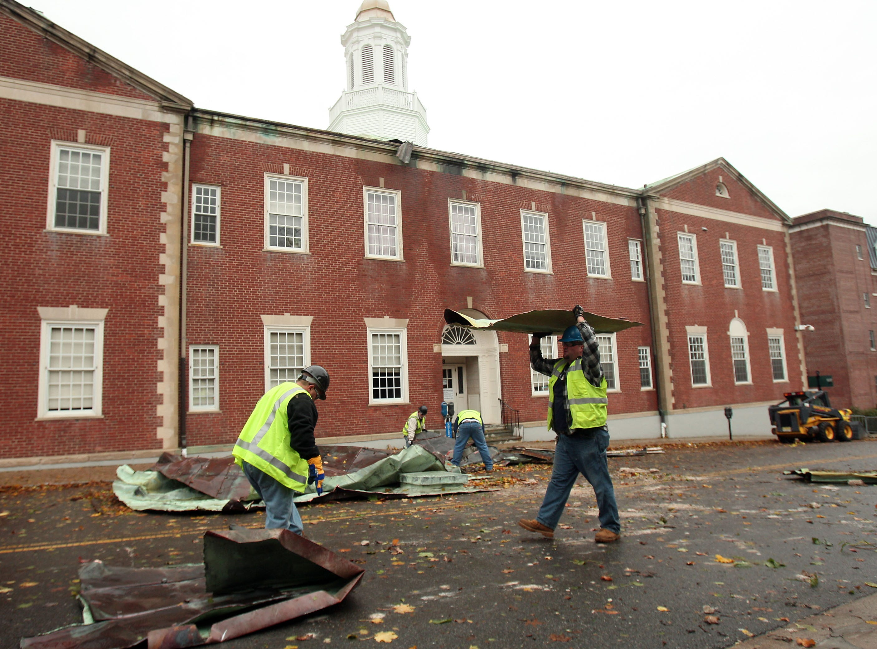 Morristown, NJ-- October 30, 2012--County grounds workers clean up after copper roofing from the Morris County Courthouse was blown off the roof due to heavy winds from Hurricane Sandy. Bob Karp/Staff Photographer/DAILY RECORD