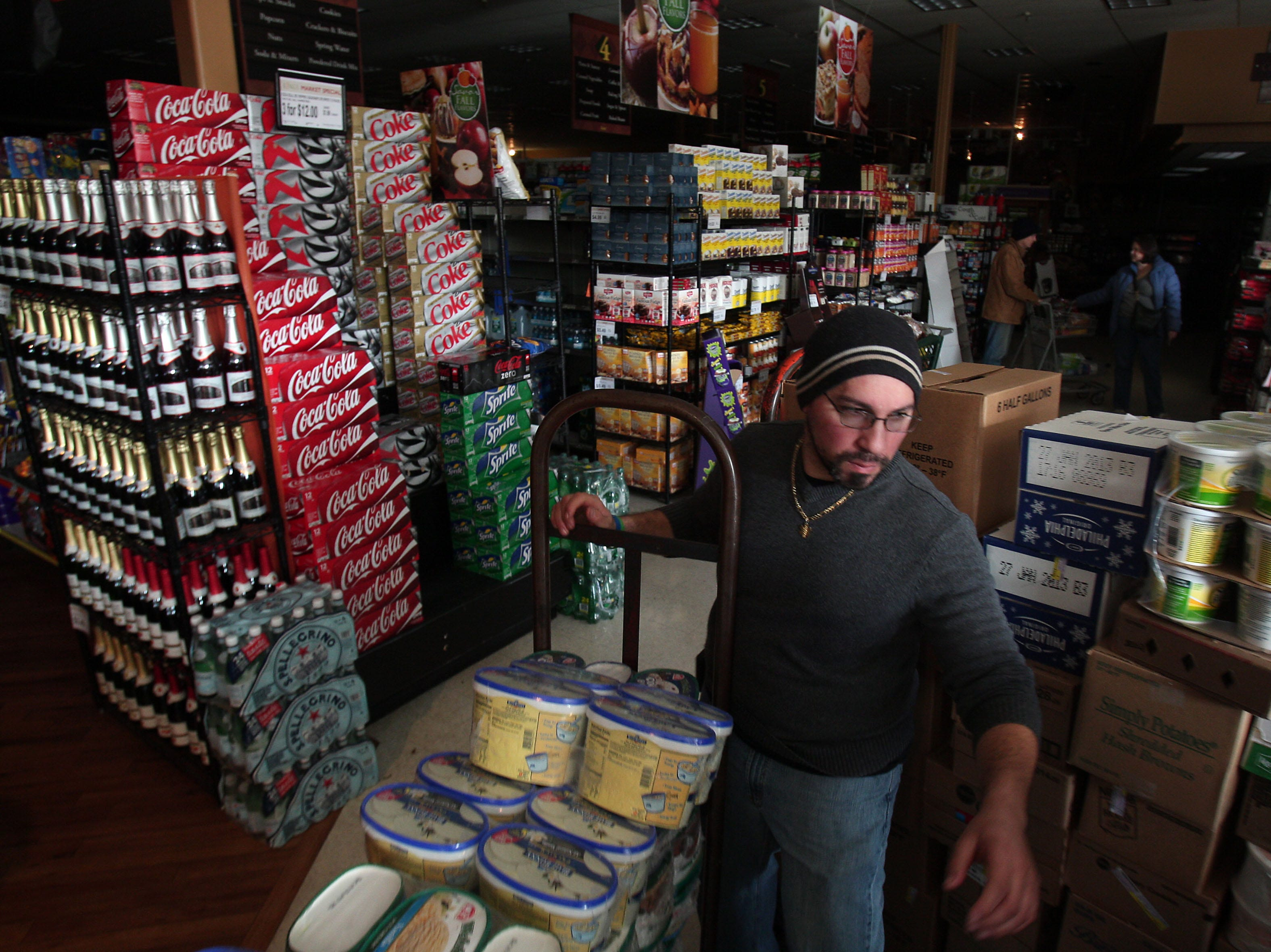 Chatham, NJ- November 1, 2012--Produce Manager Mike Toscano of Watchung, NJ packs up perishables to be thrown away at Kings in Chatham, NJ after the supermarket lost most of its power after Hurricane Sandy devastated the eastern seaboard.