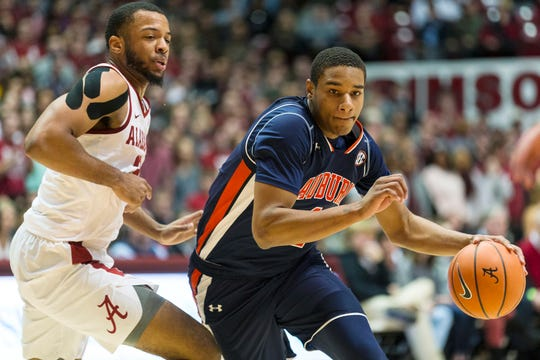 Auburn forward Chuma Okeke (4) dribbles by Alabama forward Galin Smith (30) on Wednesday, Jan. 17, 2018, in Tuscaloosa, Ala.