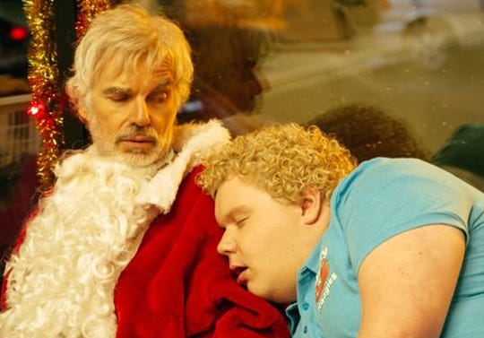 "Brett Kelly played Thurman alongside Billy Bob Thornton (left) in both the 2003 original ""Bad Santa"" and in the 2016 sequel ""Bad Santa 2."""
