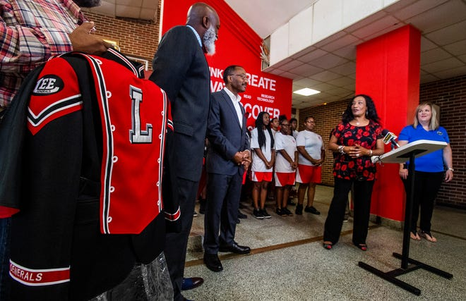 Montgomery School Superintendent Ann Roy Moore speaks as County Commissioners Isaiah Sankey and Ronda Walker each give a $10,000 gift to the Lee High School marching band for new uniforms at the school in Montgomery, Ala., on Monday October 29, 2018.