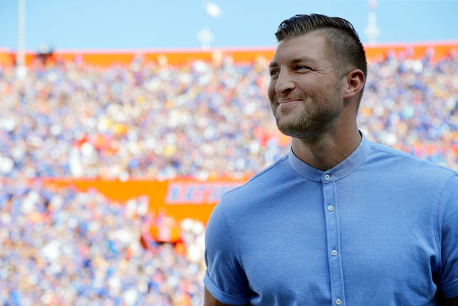 Oct 6, 2018; Gainesville, FL, USA; Florida Gators former quarterback Tim Tebow is induced into the Ring of Honor at the end of the first quarter against the LSU Tigers at Ben Hill Griffin Stadium. Mandatory Credit: Kim Klement-USA TODAY Sports