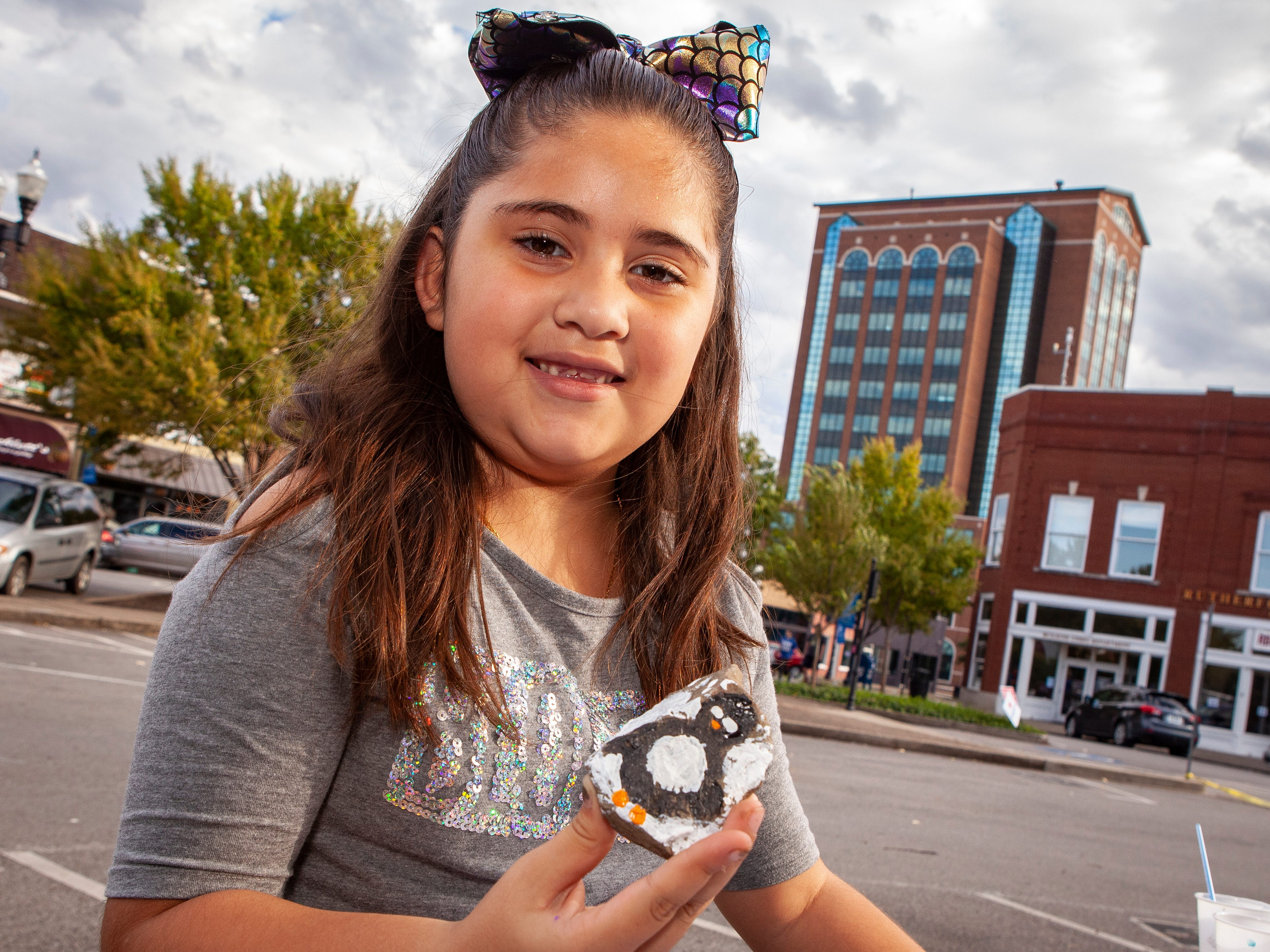 Fernanda Barron shows off a painted rock as Murfreesboro Loves celebrated the anniversary of its founding on Sunday, Oct. 28, 2018.