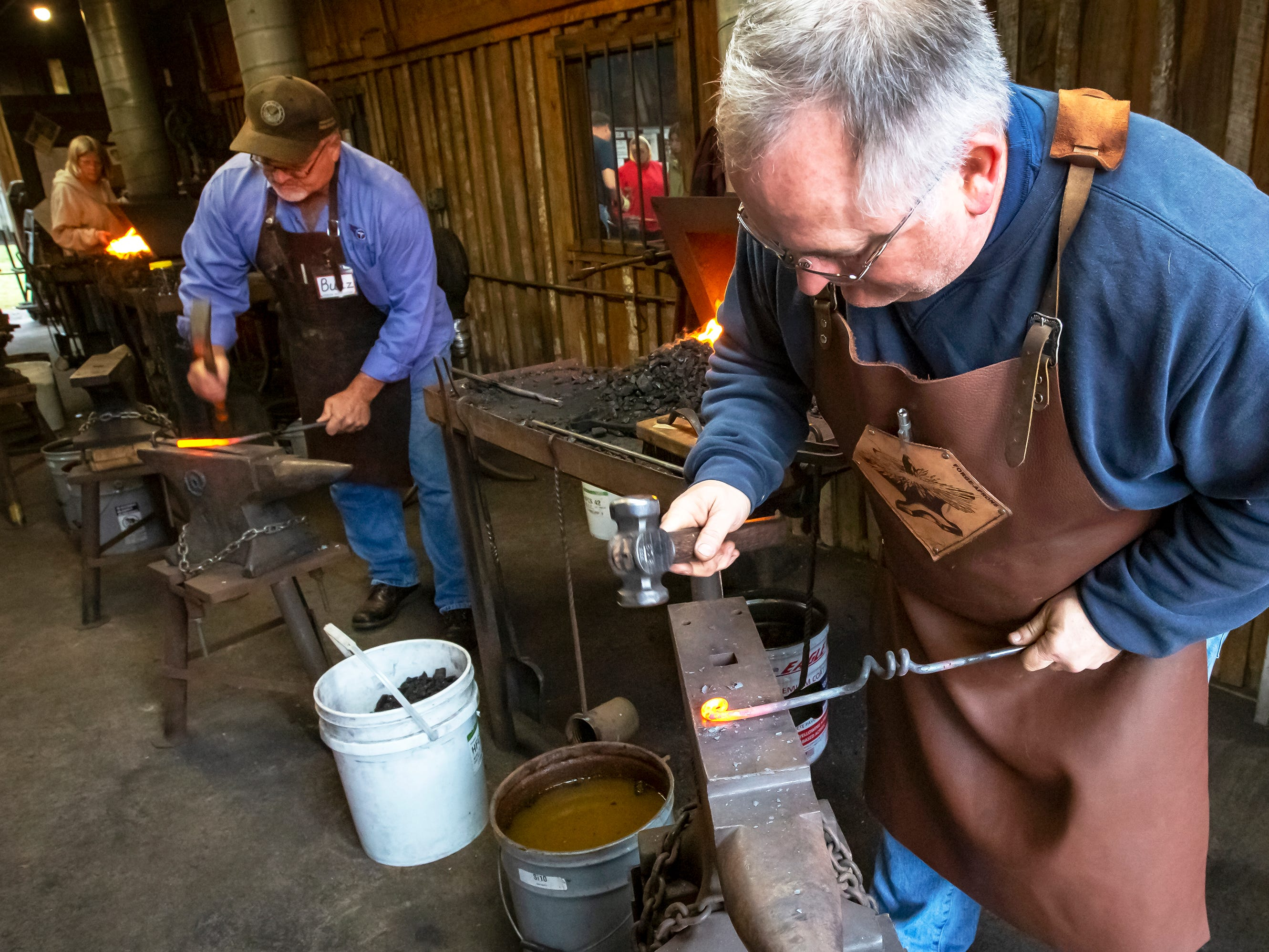 Brian Bryd and Buzz Bee demonstrates the blacksmith craft at the 43rd annual Harvest Days celebration held at Cannonsburgh Villiage.