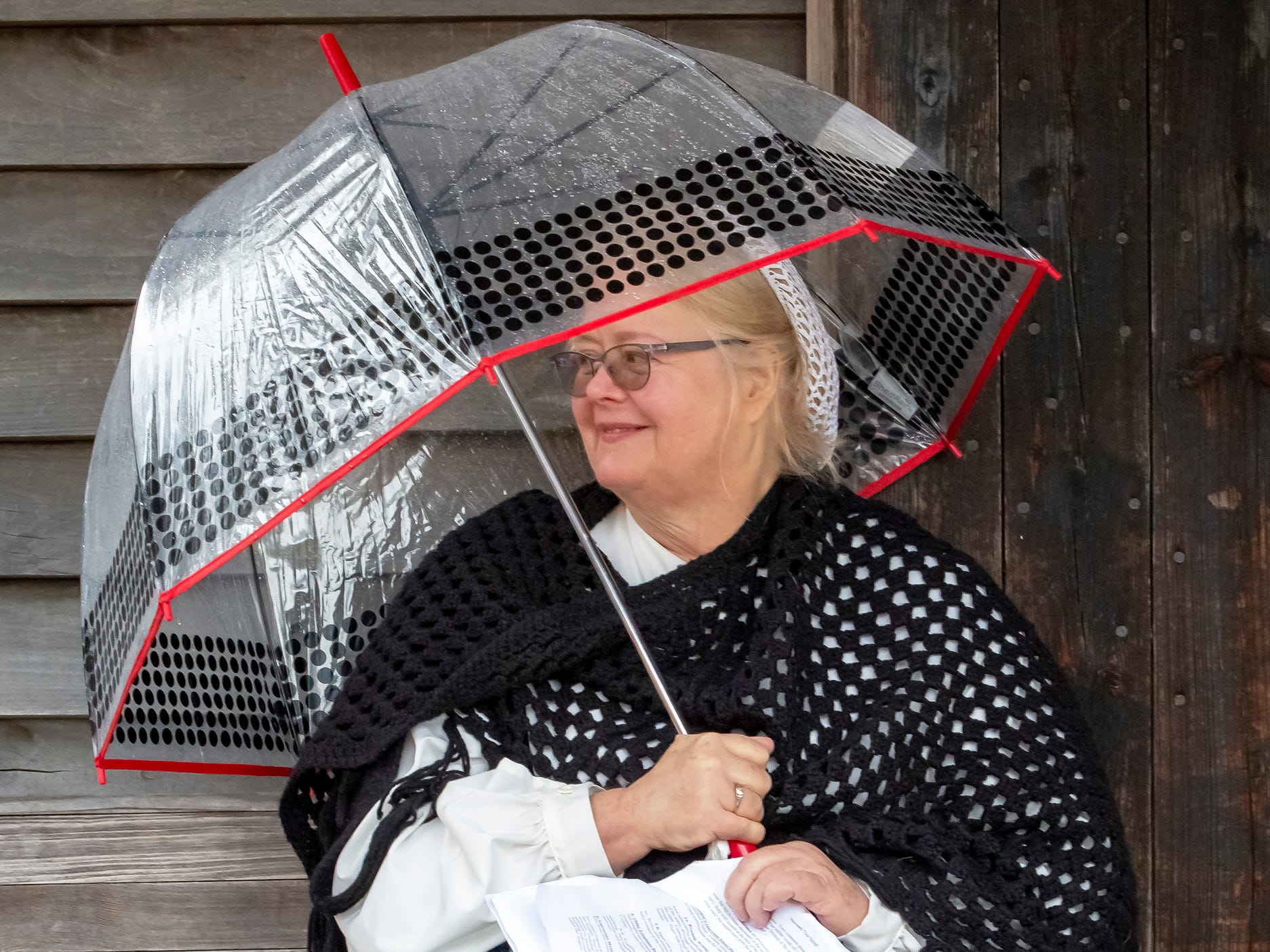Volunteer Diane Weaver stays dry under her umbrella at the 43rd annual Harvest Days celebration held at Cannonsburgh Villiage.