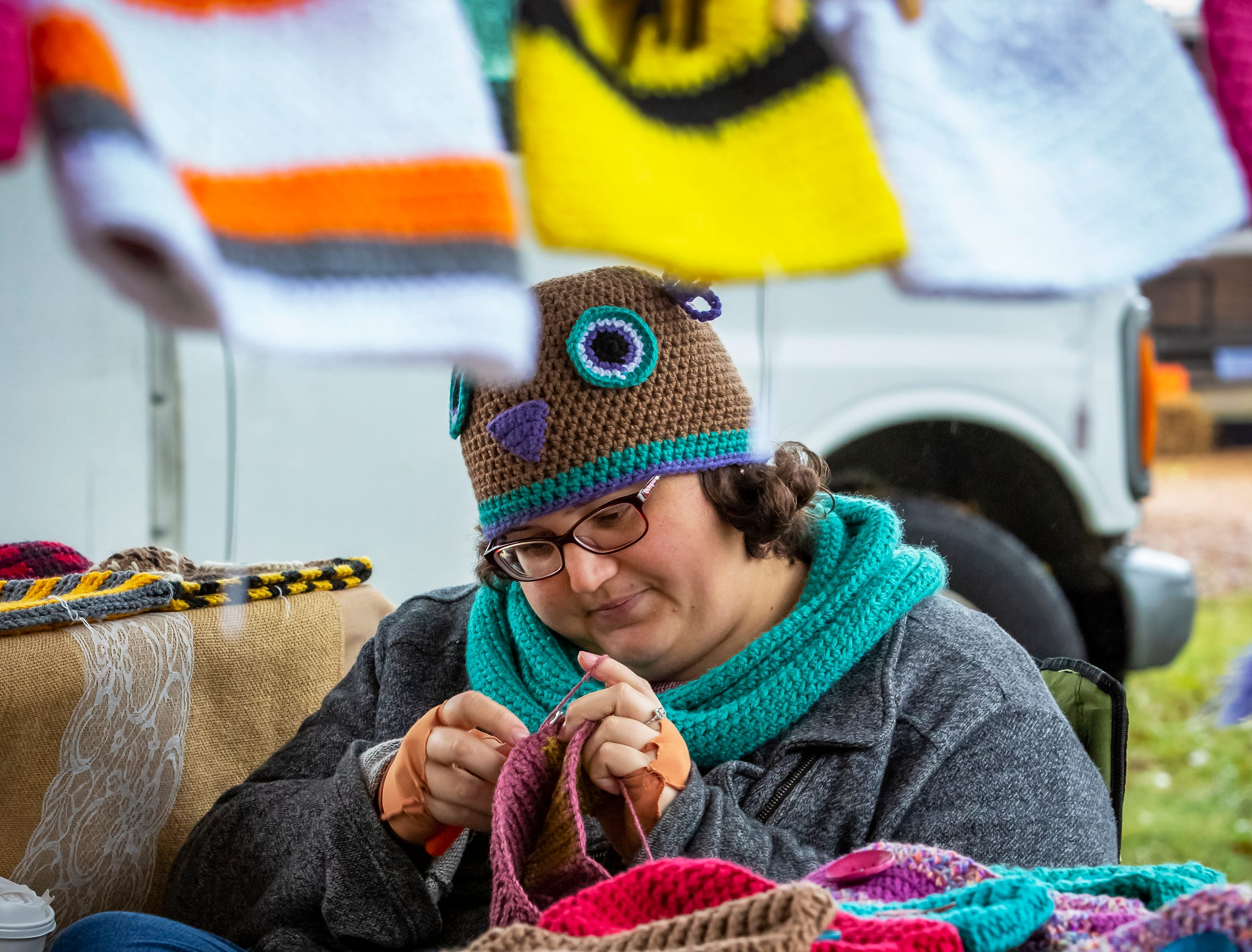 Kimberly McCall knits another hat at her booth at the 43rd annual Harvest Days celebration held at Cannonsburgh Villiage.