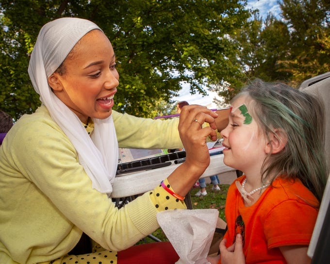 Ayana Ife paints 3-year-old Ruby Carlton's face as Murfreesboro Loves celebrated the anniversary of its founding on Sunday, Oct. 28, 2018. Ife was runner up on the fall 2017 season of 'Project Runway.'