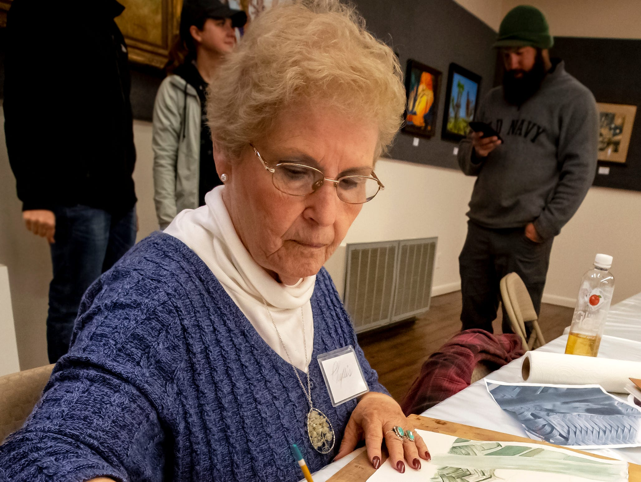 Phyllis Razo and her palette of watercolors as she works on her next creation at the 43rd annual Harvest Days celebration held at Cannonsburgh Villiage.