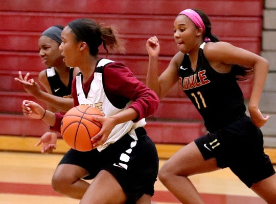 Rierdale's Alasia Hayes (1) takes the ball down the court as Riverdale's Garen Haney (34) and Aislynn Hayes (11) follow her during basketball practice on Monday Oct. 29, 2018.