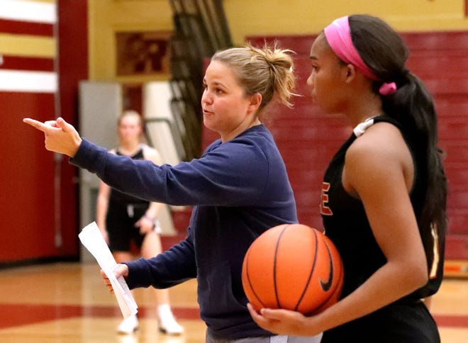 Riverdale first-year head coach Amy Josephson works with senior and MTSU commitment Aislynn Hayes (11) during Monday's practice.