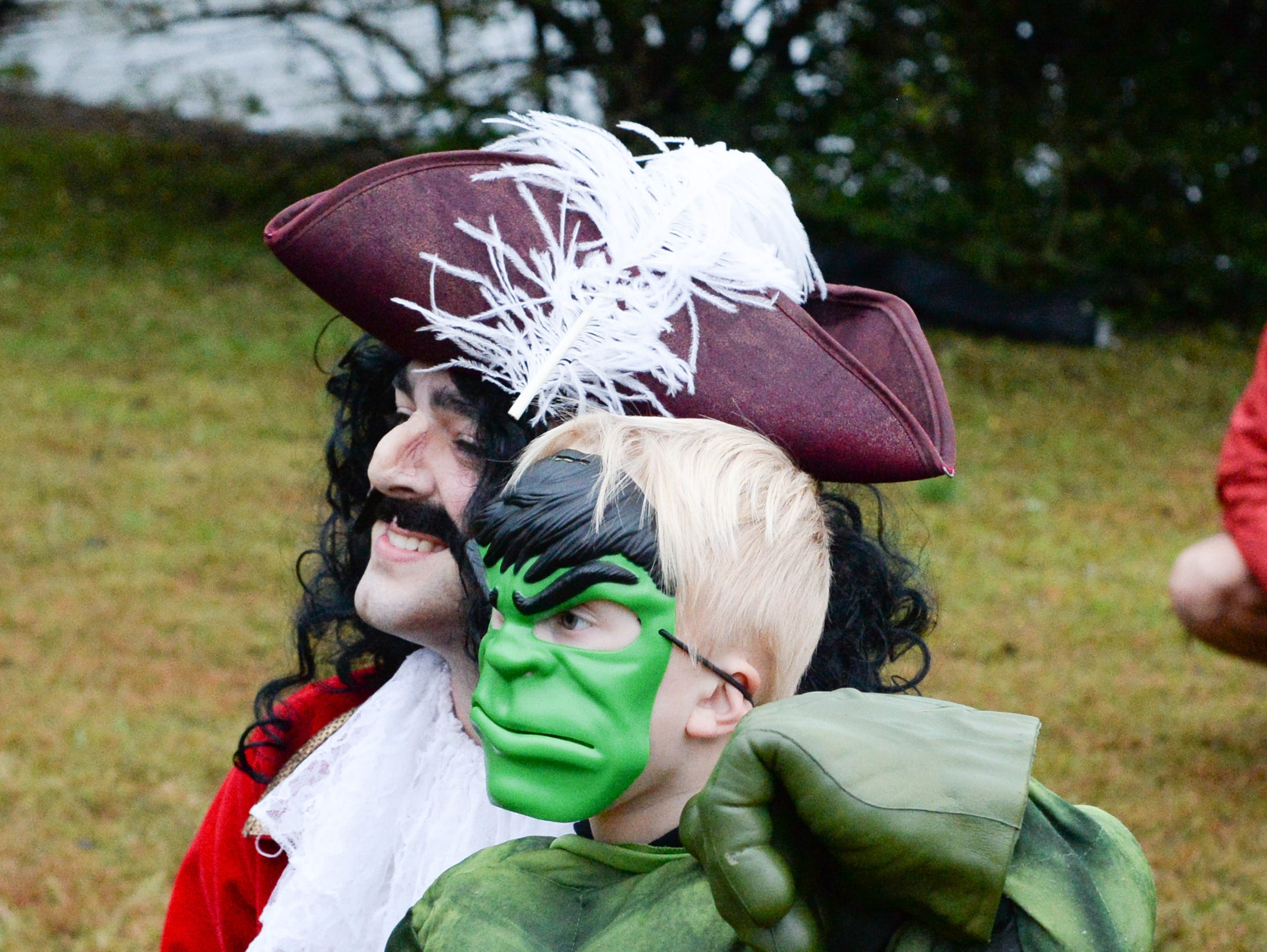 Owen Tisdale (right) interacts with characters during the Castle of Villains trick or treating event at Historic Rock Castle in Hendersonville on Friday, Oct. 26.