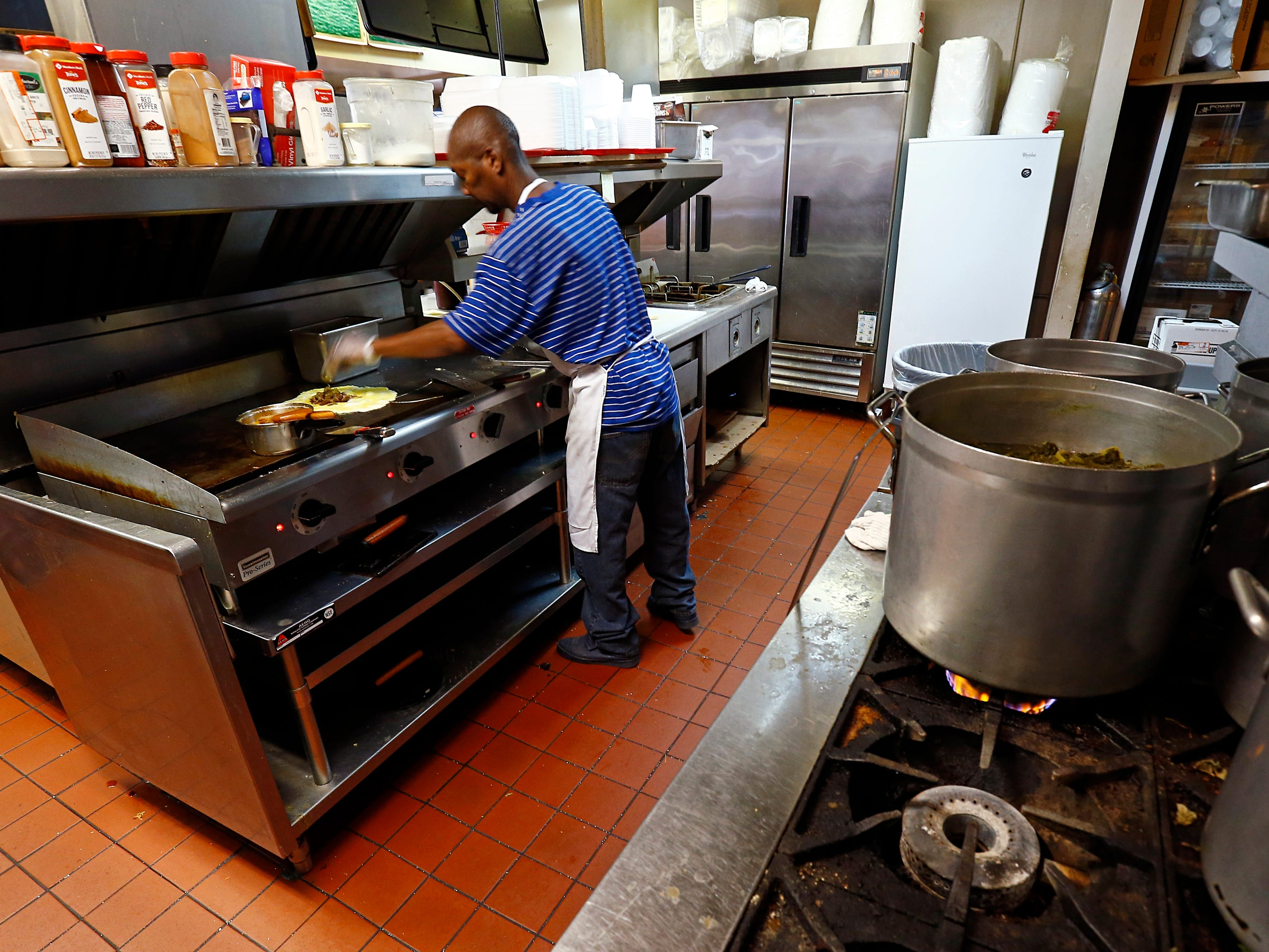 Cook Tim Boyland prepares a meal at Varallo's Chile Parlor & Restaurant Monday, Oct. 29, 2018, in Nashville, Tenn.