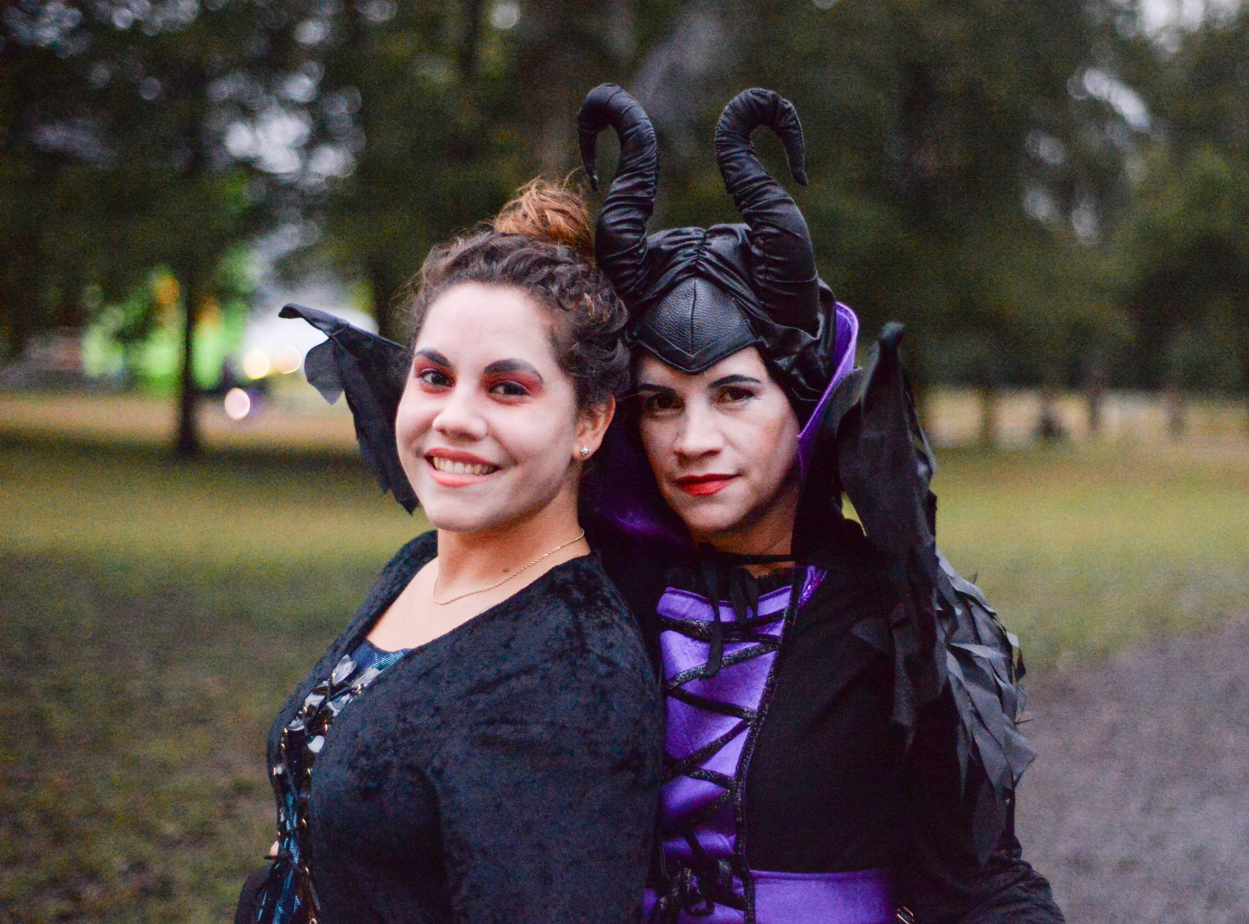 Christina Cintron and Judy Correa pause for a photograph during the Castle of Villains trick or treating event at Historic Rock Castle in Hendersonville on Friday, Oct. 26.
