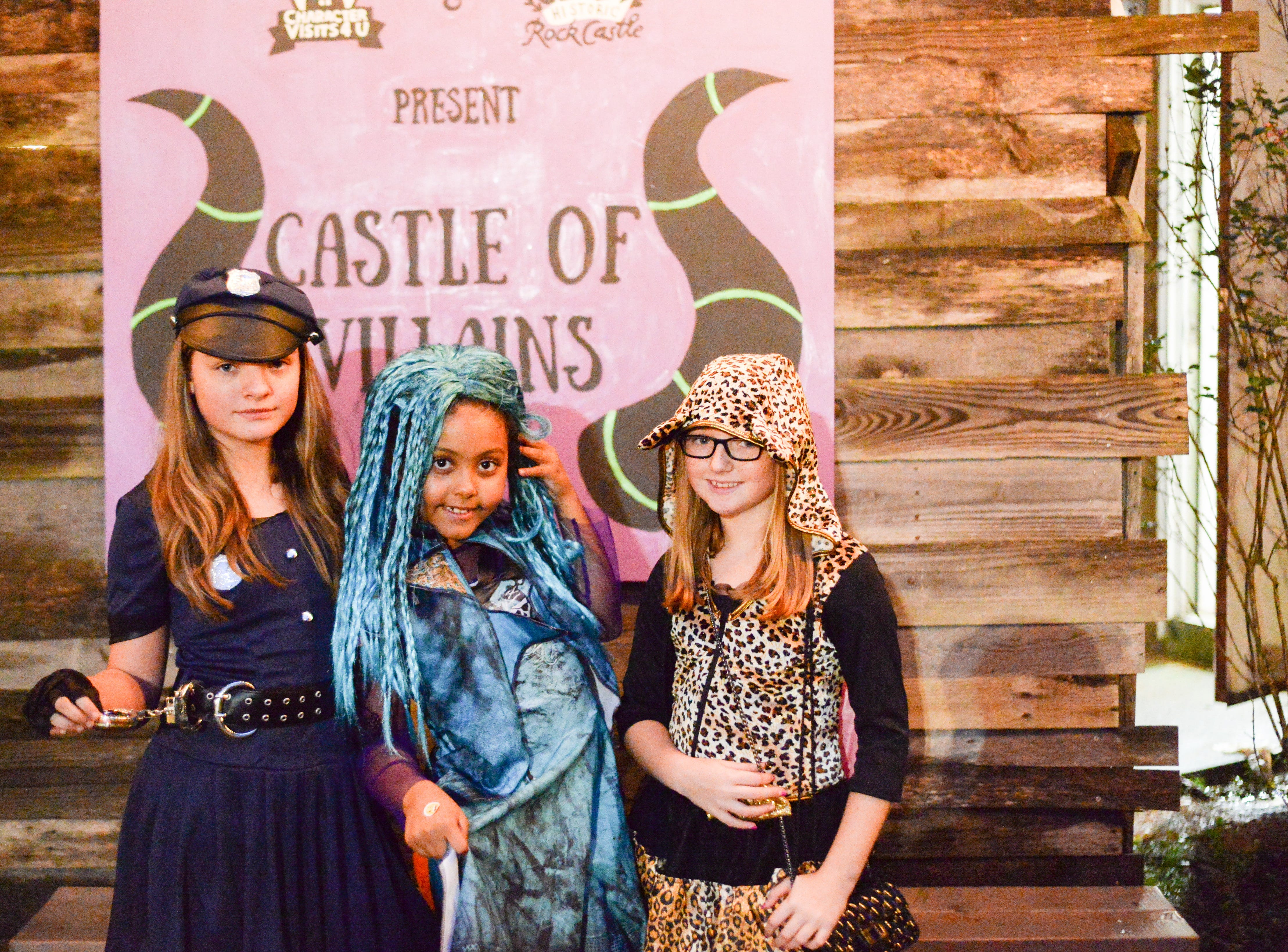Savannah, Braelyn and Kaci have a blast at the Castle of Villains trick or treating event at Historic Rock Castle in Hendersonville on Friday, Oct. 26.