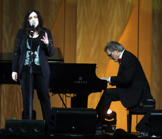 Brandy Clark and Mike Reid perform during the 48th Anniversary Nashville Songwriters Hall of Fame Dinner and Induction Ceremony at the Music City Center Sunday, October 28, 2018.