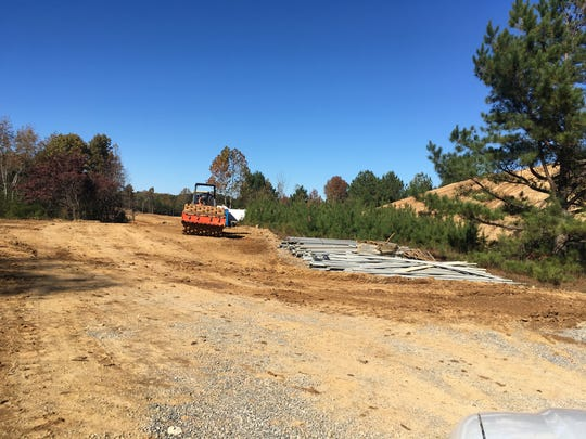 Heavy equipment is moving earth on the site of the future Audubon Cove development on Highway 100 in Fairview.