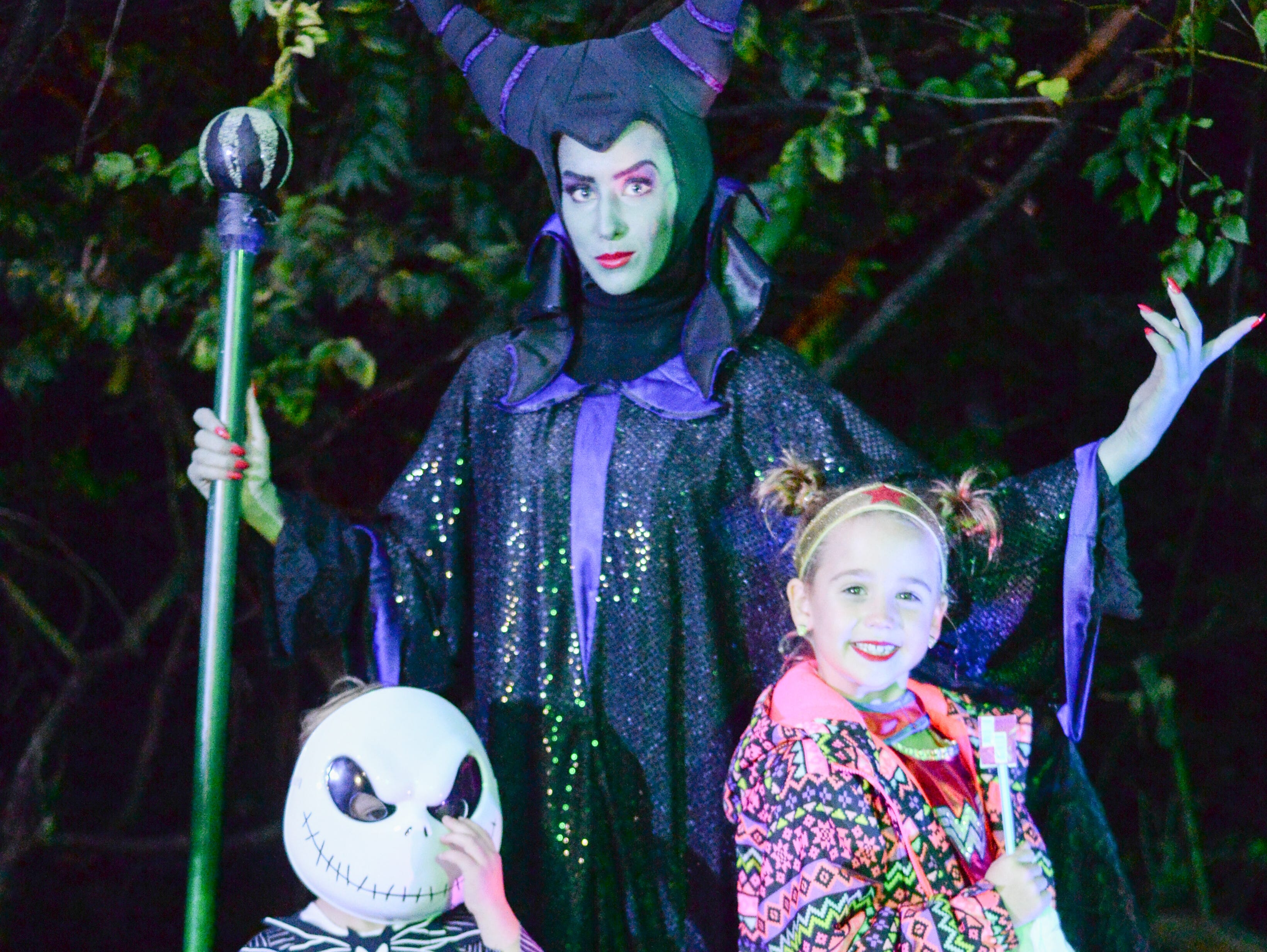 Attendees find surprises on spooky trails during the Castle of Villains trick or treating event at Historic Rock Castle in Hendersonville on Friday, Oct. 26.