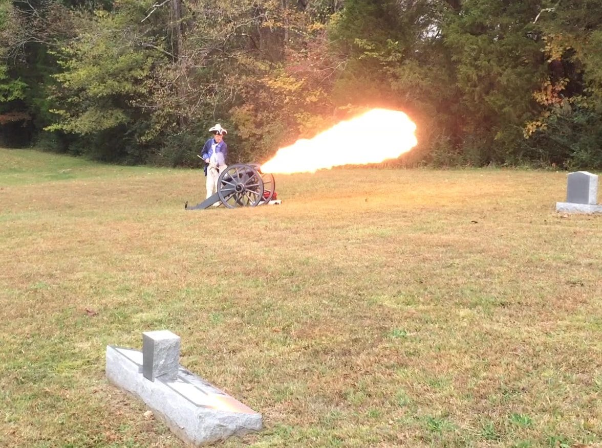 A cannon is fired of at ceremony honoring Gideon Carr at Stuart Cemetery in Dickson County.