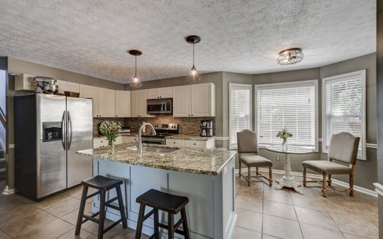 The interiors of the home were minimalized with more personal items removed.  Listing agent Megan Robinson said the staging helped earn six offers above asking price the first day the home was on the market.